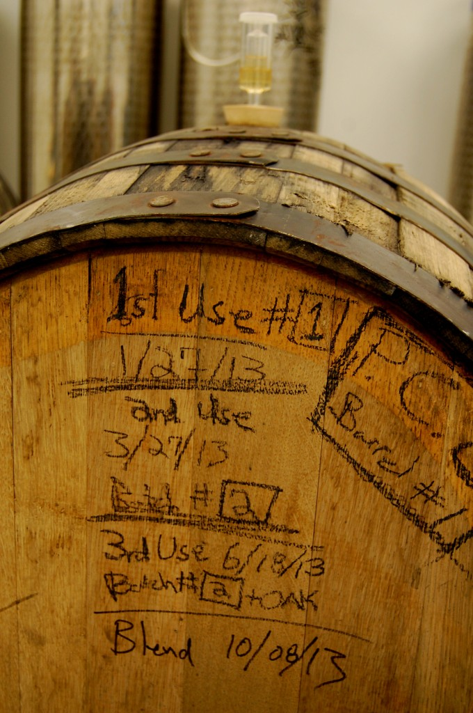 A barrel used for aging cider with etched details.