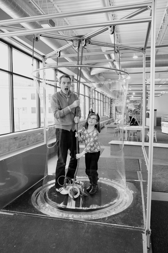 Father and daughter in Grand Rapids Children's Museum bubble maker