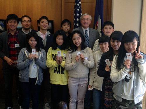 Omi Brotherhood students meeting Grand Rapids Mayor.