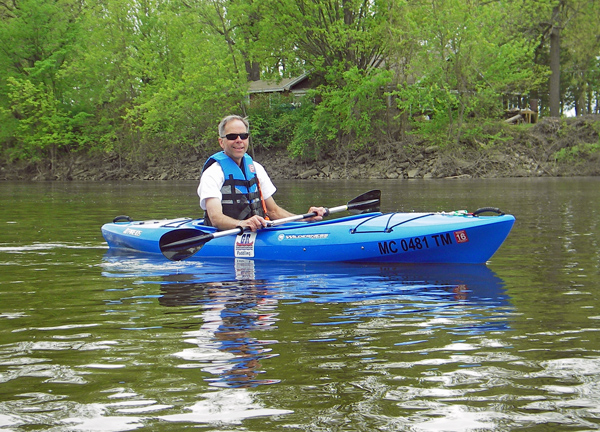 Jeff Neumann is enjoying a float on the Grand River. Credit: Howard Meyerson