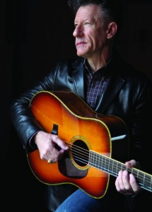 Lyle Lovett holding a guitar