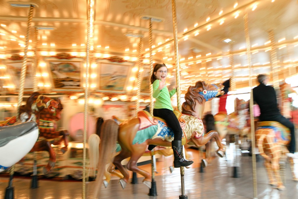 girl on Spillman Carousel in the Grand Rapids Public Museum