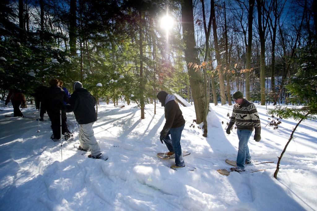 People snowshoeing in Hoffmaster State Park