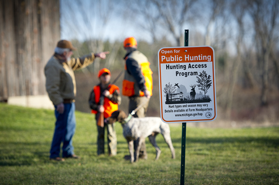 A Grand Rapids Directs Hunters on His Property