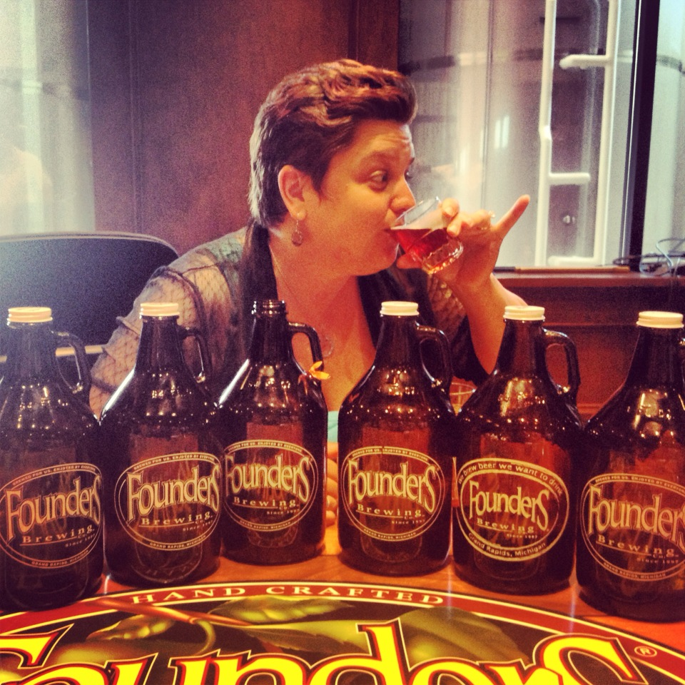 Jenna from Amore Trattoria sipping a Founders Brew.