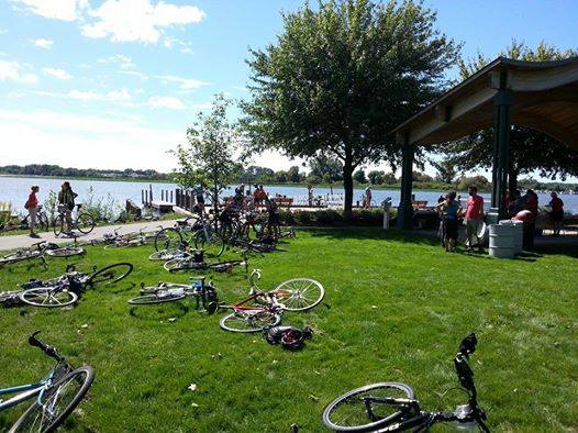 Climate Ride Midwest riders taking a break along the lakeshore. Photo courtesy of Justine Burdette