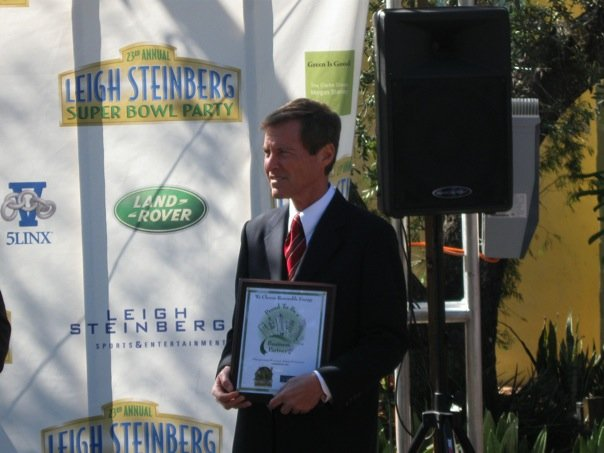 Mr. Steinberg accepts his plaque