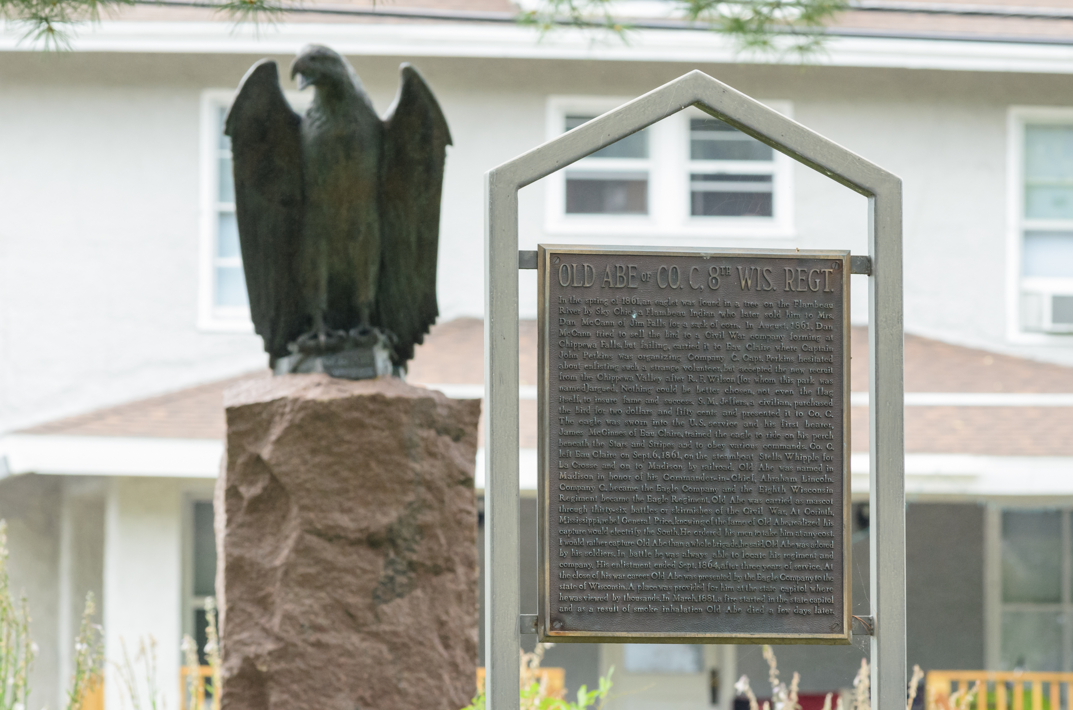 A statue of Old Abe and a historic marker about the eagle stand in downtown Eau Claire's Wilson Park. Photo by Lee Butterworth/Volume One