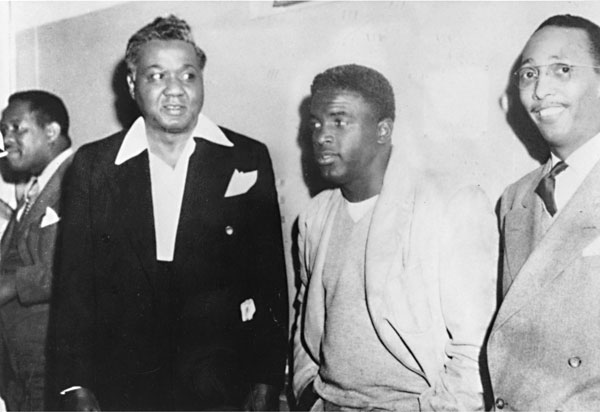 Pictured: Kenneth Lankins, Dr. E.H. Givens, Jackie Robinson, and the Rev. Karl Downs; date unknown)  Photo taken from the Austin History Center