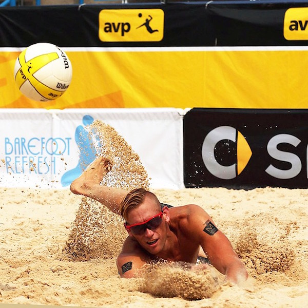 Casey dives for a ball during the AVP tour