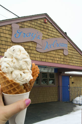 "Often regarded as a ""Rhode Island Icon,"" Gray's Ice Cream in Tiverton has been soothing the sweet-tooth cravin gs of locals and visitors alike since 1923 when owner Annie Gray began selling ice cream from the back window of her house. Today, the legendary ice cream shop boasts more than 40 flavors, from ever-pleasing classics like cookie dough and mint chocolate to seasonal flavors like eggnog and pumpkin, and even the unexpected rum raisin and frozen pudding. With myriad options, it's no wonder they've won countless awards."