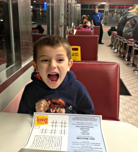 Child dining inside oasis diner