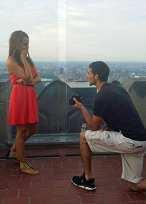 Evan proposes to Kayla Hunter on top of Rockefeller Center in New York City.