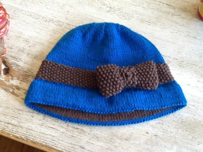 This Flapper-style hat is January's Taste of Nomad project at Nomad Yarns in Plainfield, Indiana
