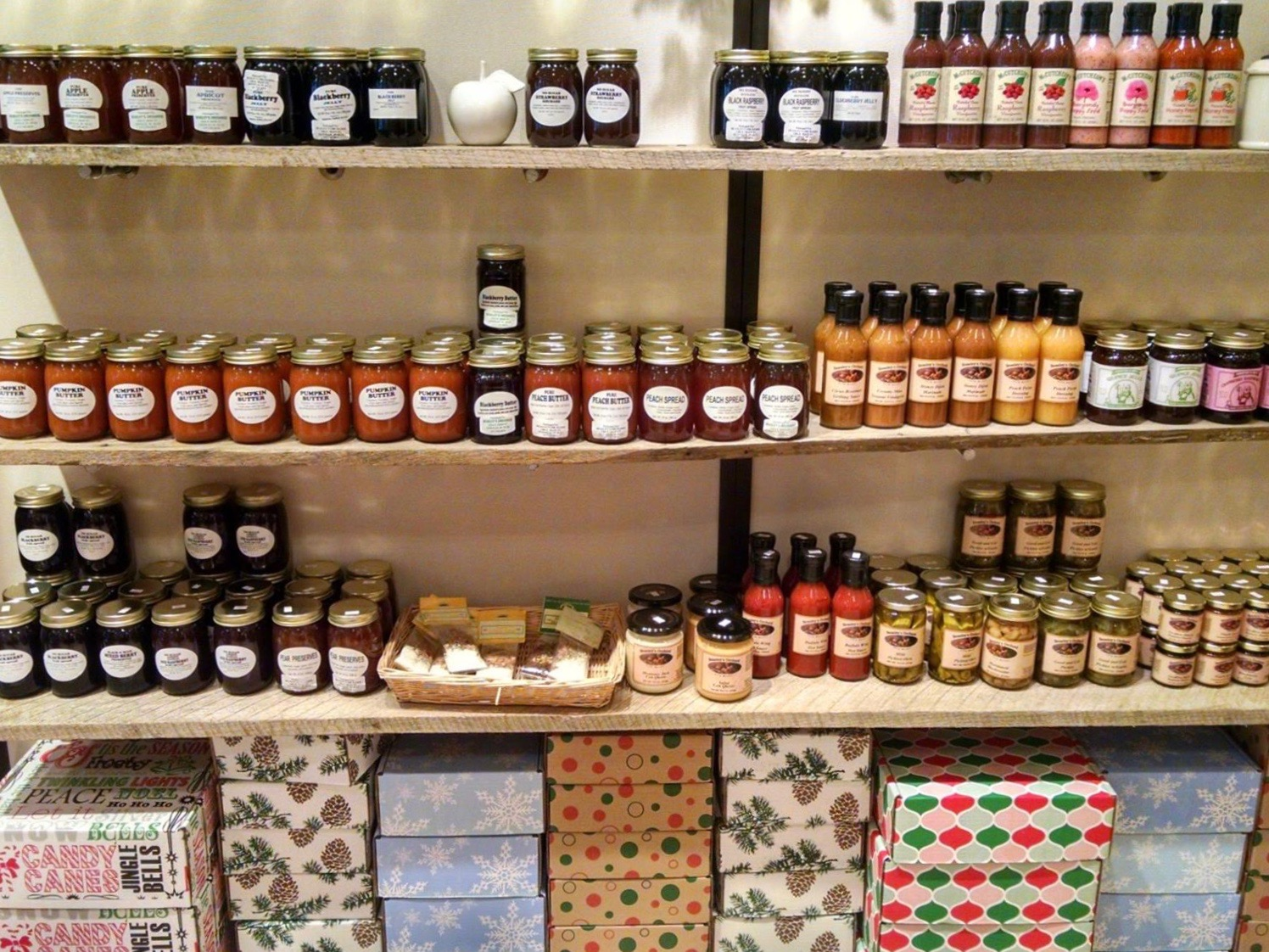 Pick a gift box, like the ones at the bottom of this photo, and fill it with all sorts of goodies for a unique, local Christmas gift.