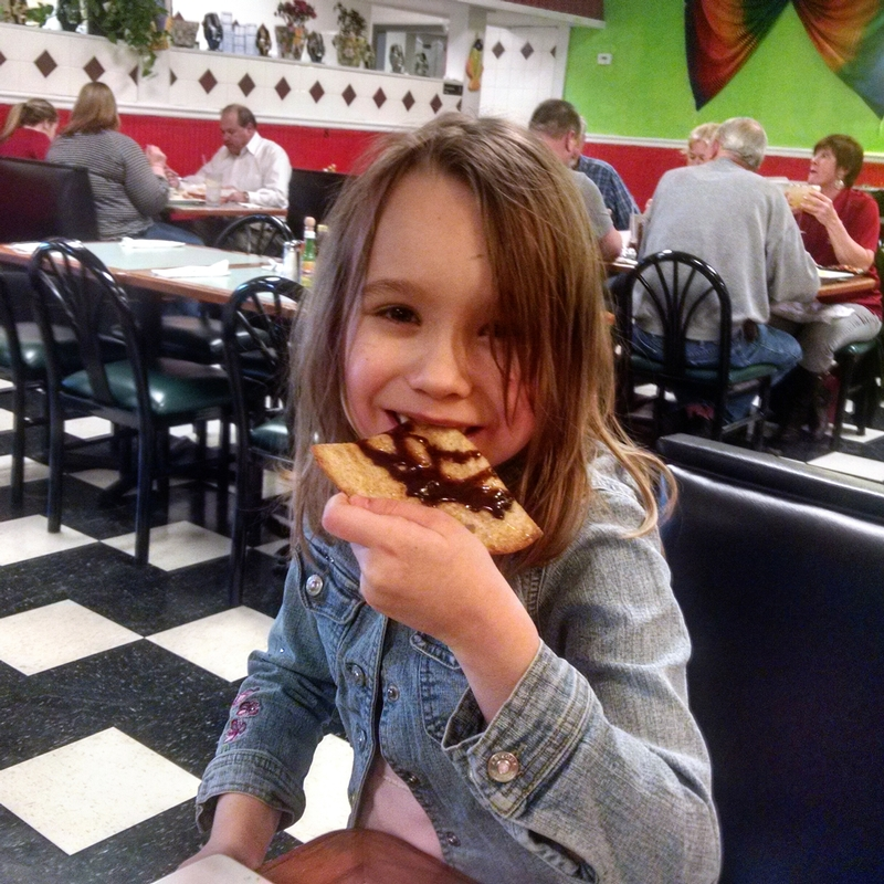 My youngest daughter devours her sopapilla at Los Patios Mexican Restaurant in Danville, Indiana.