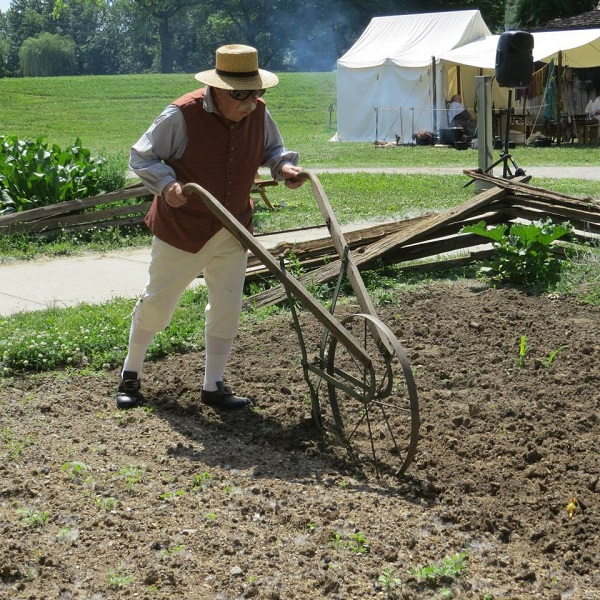 A man is working in a garden at the Fort
