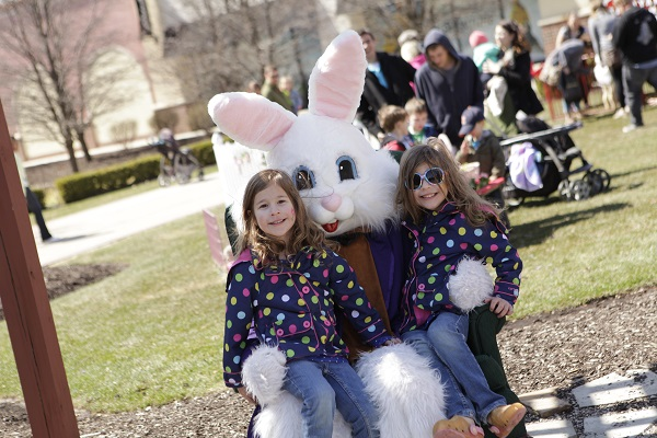 Two girls have their picture taken with the Easter Bunny at Jefferson Pointe
