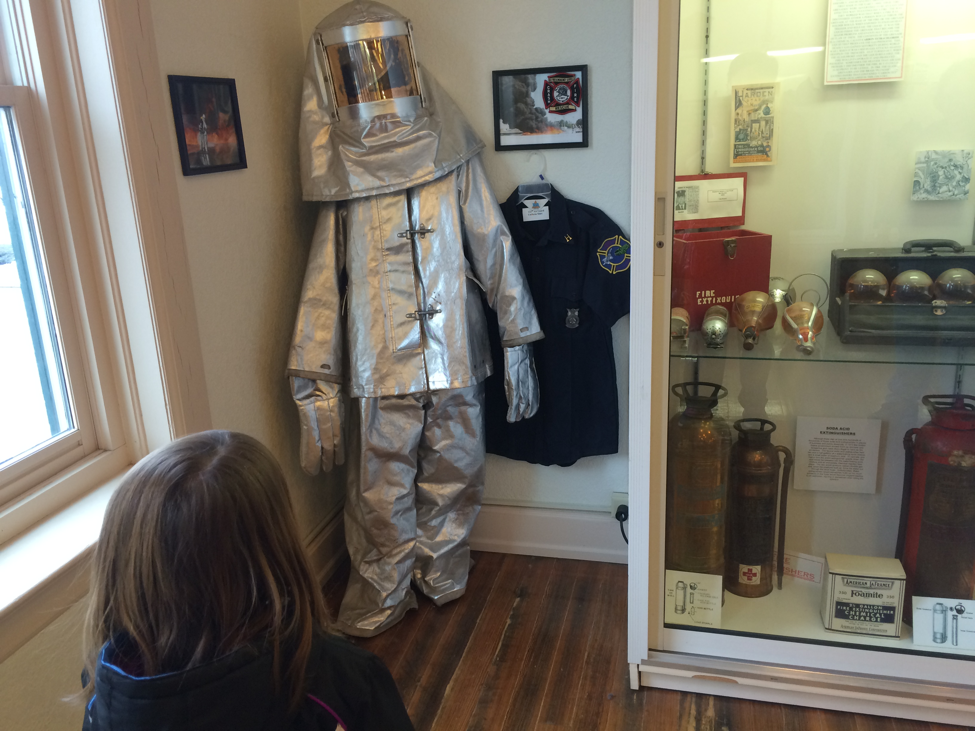 Protective fire suit for fires on airplanes