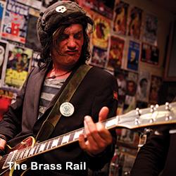 Brass Rail Guitar Player