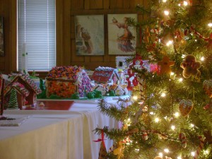 Soft lights from delicate trees illuminate the Festival of Gingerbread display room.