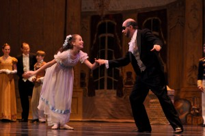 Clara and Herr Drosselmeyer dance in the Nutcracker