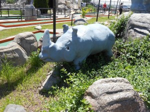 A friendly, little rhinoceros greets visitors to Putt-Putt golf.