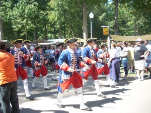 Drum & Fife Corps march through the festival grounds.