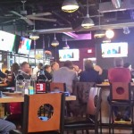 More than a dozen large televisions surround the bar area at Scotty's.