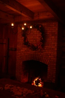 What could feel more like Christmas than a warm fire, a pine wreath and candles?