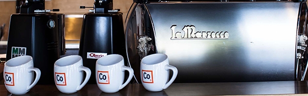 Image of coffee mugs inside of Elemental Coffee in the Midtown District of Oklahoma City.