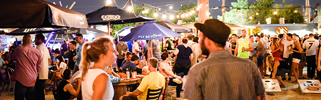 Image of people at Bleu Garten, an outdoor patio bar in the Midtown District of Oklahoma City.