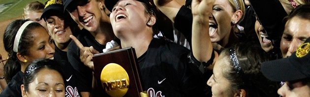 Image of softball players celebrating after winning.