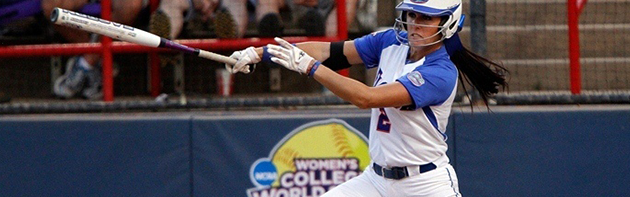 Image of softball player swinging baseball bat.