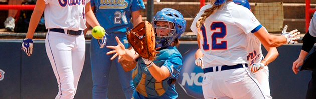 Image of a softball player catching an incoming ball.