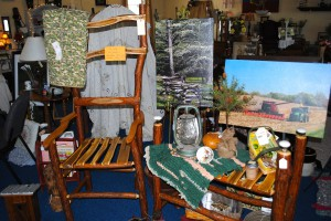 A sassafras chair, some photography, and other items created by local artists available at the Red Horse Livery in Coatesville.