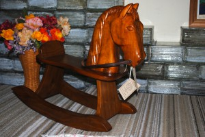 This rocking horse was handcrafted by a local man who is now unable to work with wood due to health issues. This is one of his last pieces, available at the Red Horse Livery.