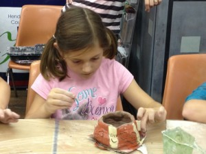 One of the girls working on her pumpkin/ghost bowl.