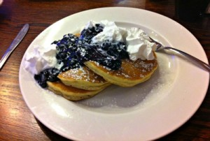 Blueberry pancakes with whipped cream
