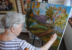 One of Sally's students working on painting.