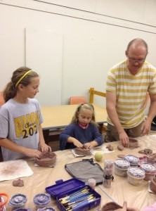 My daughter (left) and other participants start to build up their bowls.