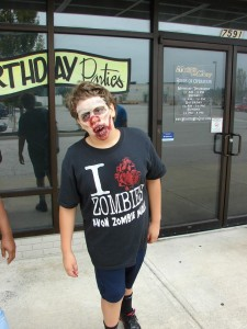 Jon Barker, an 11-year-old sixth-grader, is the braaaaaiiins behind the Avon Zombie Walk on Oct. 26.  (Photo courtesy of Matthew Dudley Photography)