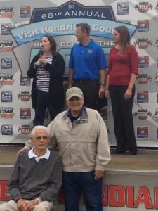 A.J. Watson (seated at bottom during pre-race ceremonies), a USAC Hall of Fame inductee, was last year's Visit Hendricks County Night Before the 500 Grand Marshal. Will you be on that stage this year?