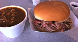 pulled pork sandwich and a side of baked beans