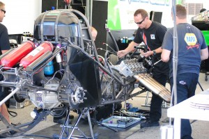 "The Schumacher Racing Team makes a couple ""minor"" adjustments to their Top Fuel Car."