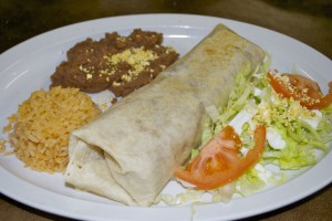J's Burrito with refried pinto beans, rice and salad.
