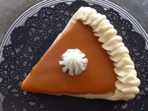 A sugar cookie decorated as a slice of pumpkin pie at Sweetheart Cupcakes.
