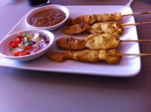chicken satay with a sweet and sour sauce and peanut sauce