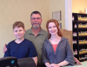 Owner of Real Food Shoppe Bob Ridenour with two of his children.