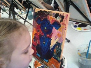 My daughter, 4 years old at the time, working on her Cookies & Canvas painting.